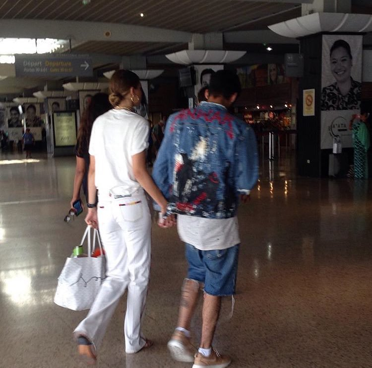 airport, back, boy and girl, couple, holding hands